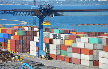 Port cargo crane and container over blue sea background