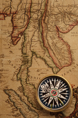 Wall Mural - Old compass and map