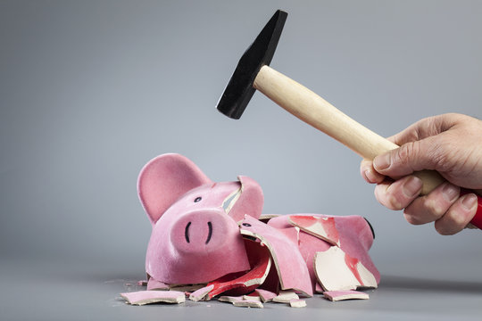 Robbing piggy bank with hammer