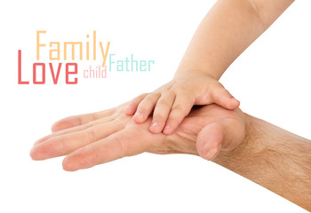 baby hand with father's hand