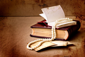 retro picture of a necklace lying on a book