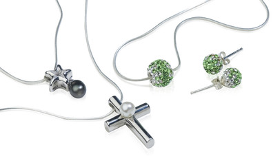Silver Cross and diamond jewelry isolated on white
