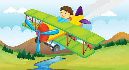 A boy and a flying airplane