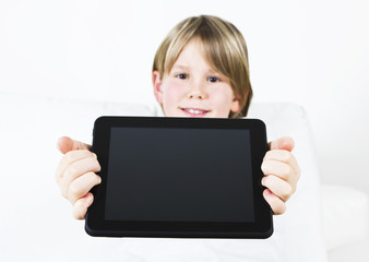 Portrait of a cute little boy with tablet