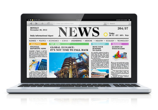Laptop with business news site on screen