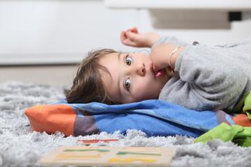 kid lying on the floor