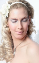 Young blonde woman with fancy makeup