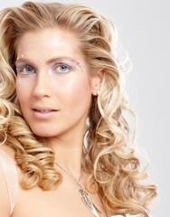 Closeup portrait of blonde woman with fancy makeup