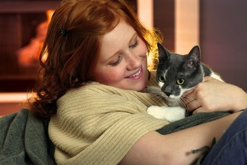 Happy redhead girl with cat