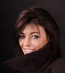 Artistic portrait of brunette on a dark background