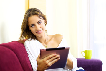 Beautiful woman relaxing with tablet
