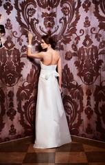 sexy  happy bride in white wedding dress in interior