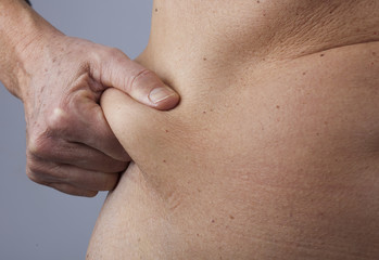 female person checking her belly fat