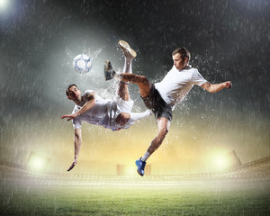Deurstickers voetbal two football players striking the ball