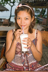 Young woman drinking soybean milk