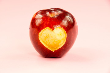 Valentine's day apple with heart on pink background