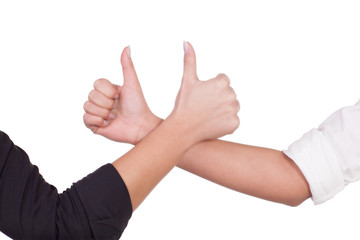 Two women give a thumbs up