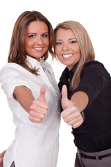 Two beautiful women giving a thumbs up sign