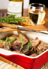 Rabbit stewed with white wine and herbs