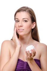 Beautiful woman cares of skin
