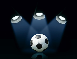 three spotlights and a soccer ball