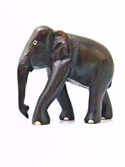 A wooden elephant doll isolated on white background in profile v