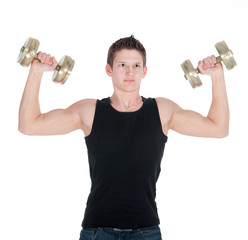 Portrait of a healthy young man doing exercise with dumbbell