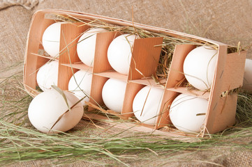 eggs in a wooden container