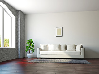 Livingroom with sofa and a plant