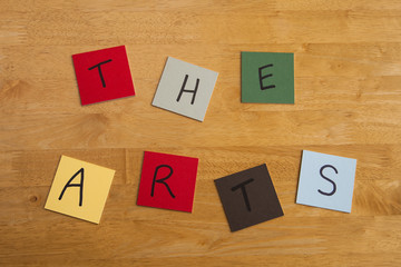 'The Arts' in words on square color tiles - culture, education.