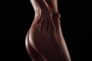 Sexy wet body of slim woman