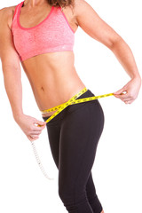 woman using a tape measure to measure her waist size