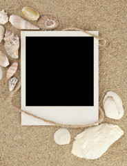 Old photo on the sand with shells