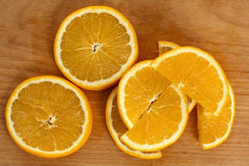Juicy oranges on a wooden tray