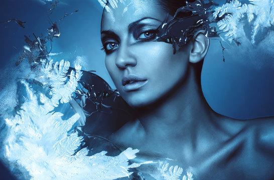 portrait of winter woman with snow splash