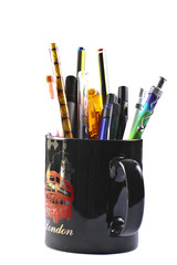 cup with pens
