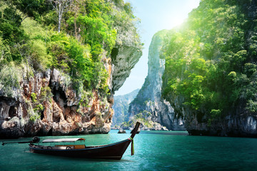 Wall Mural - long boat and rocks on railay beach in Krabi, Thailand