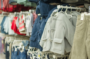 Winter jackets and trousers for kids in supermarket