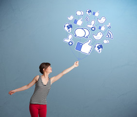 Pretty woman holding social icon balloon