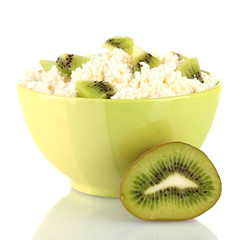 Cottage cheese in color bowl with kiwi fruit, isolated on white