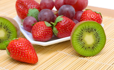 juicy ripe berries and fruit - kiwi, strawberries and grapes.