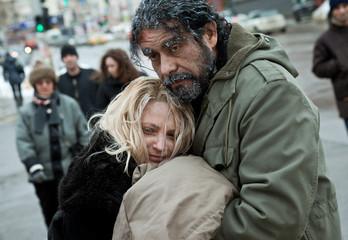 Homeless frozen couple embracing