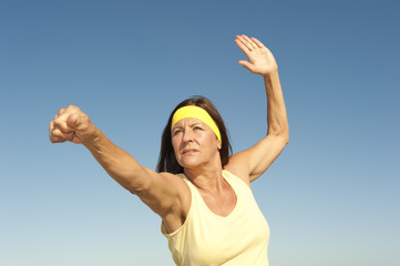 Middle aged woman exercising outdoor isolated