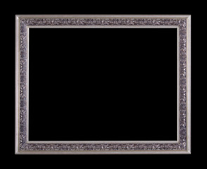 Vintage metal picture frame in silver color isolated over black