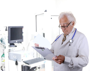 doctor in pulmonary function lab looking at a clipboard