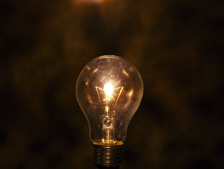 light bulb with low key   background conception for idea cr
