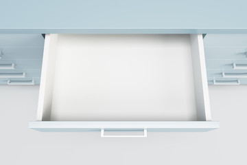 Fototapeta cupboard with opened drawer obraz