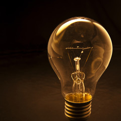 light bulb with low key  background conception for idea creative