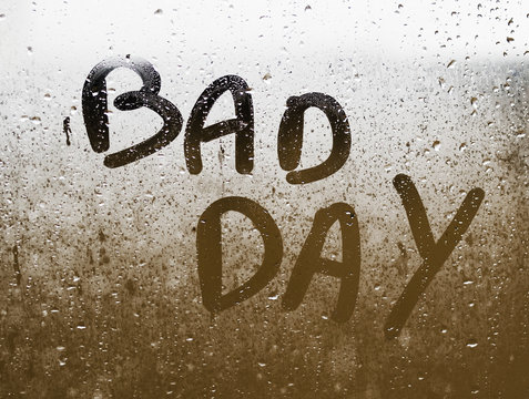 """Text """"BAD DAY"""" written in a crystal"""