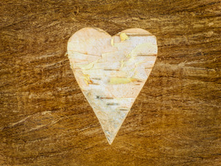 Wooden heart shape on a retro wooden background